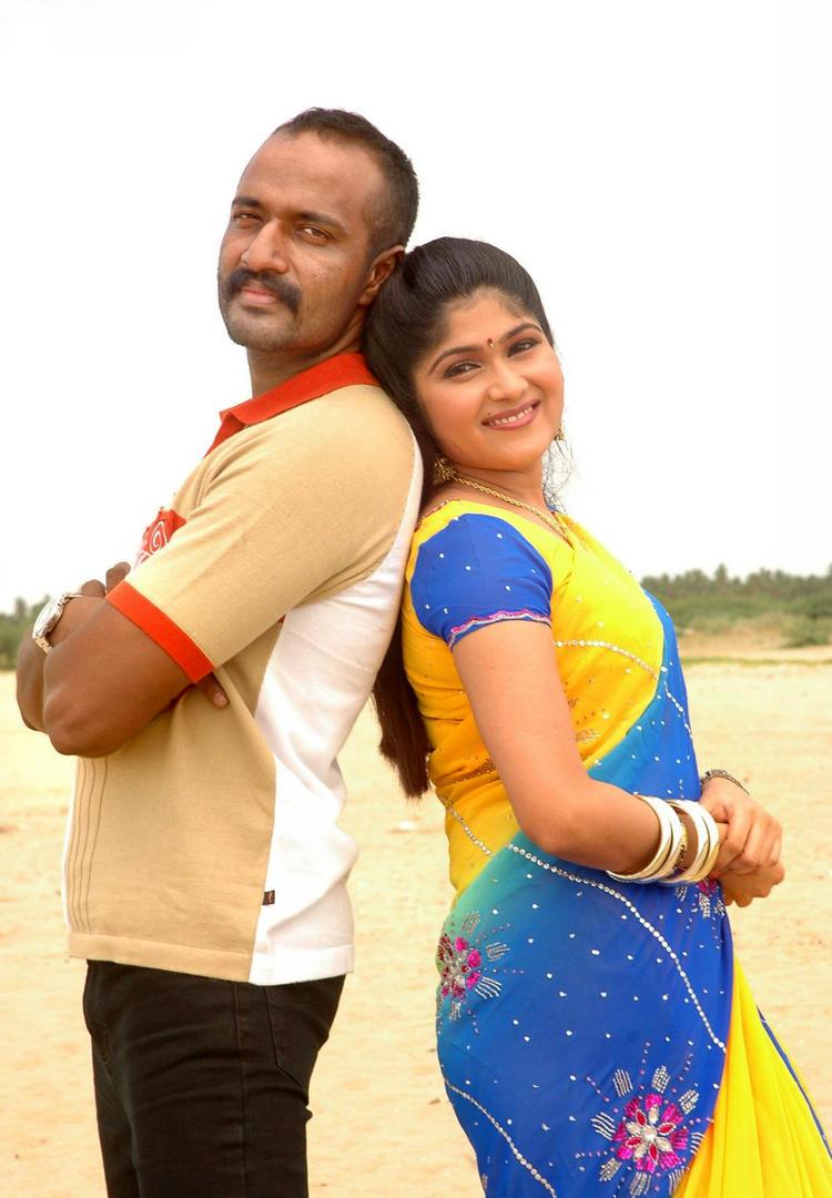Kishore And Devi Krupa Cute Look Photo Still From Movie Dandupalyam Police