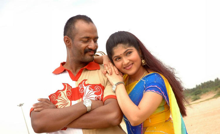 Kishore And Devi Krupa Cute Smiling Photo Still From Movie Dandupalyam Police
