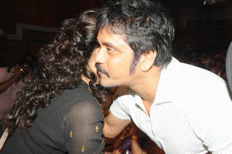 Handsome Nagarjuna Hugging Still At TSR-TV9 National Film Awards 2011-2012 Presentation Function