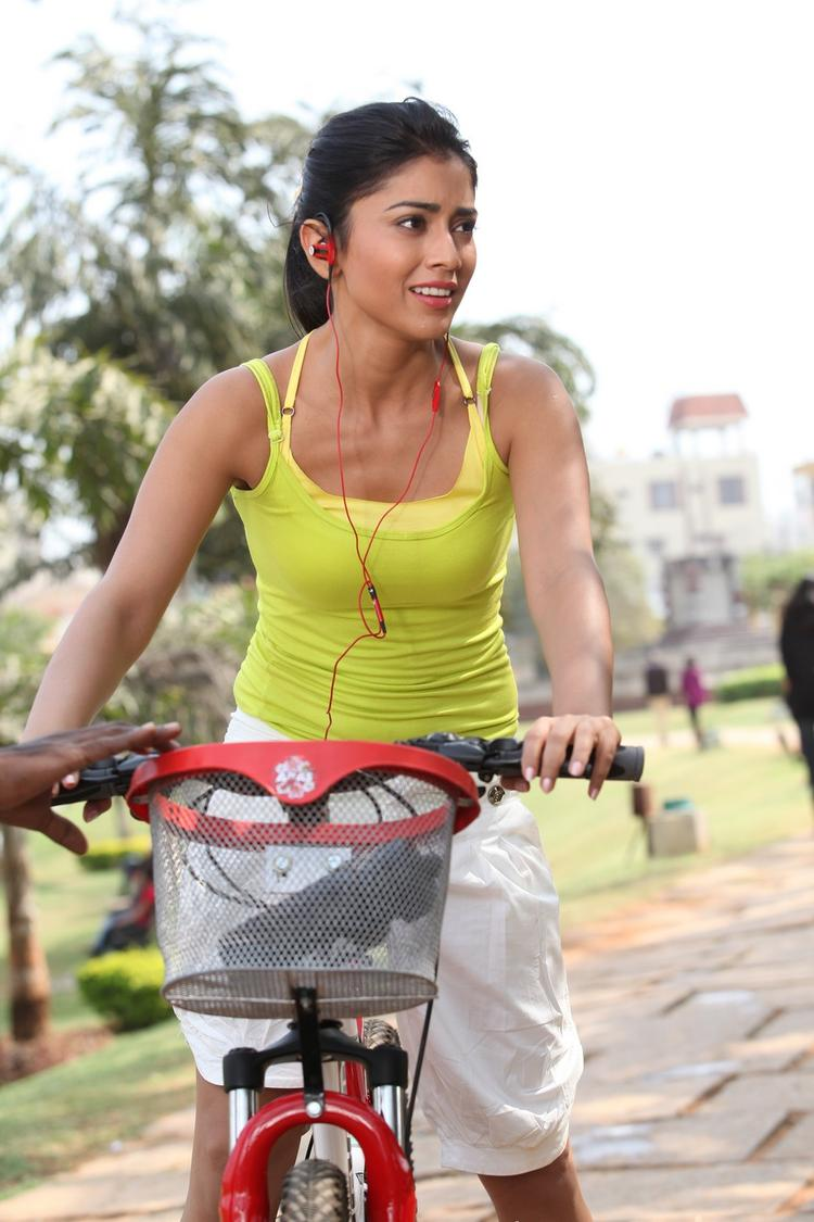 Shriya Saran With Cycle Still From Pavitra Movie
