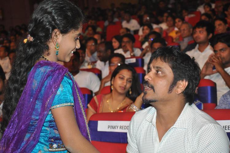 Nagarjuna And Baby Annie Chatting Still At TSR-TV9 National Film Awards 2011-2012 Presentation Function