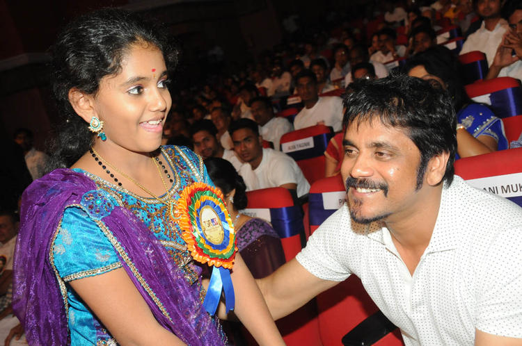 Nagarjuna And Baby Annie Cool Smiling Look At TSR-TV9 National Film Awards 2011-2012 Presentation Function