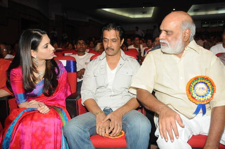 Tamannaah And K.Raghavendra Rao Chatting Still At TSR-TV9 National Film Awards 2011-2012 Presentation Function