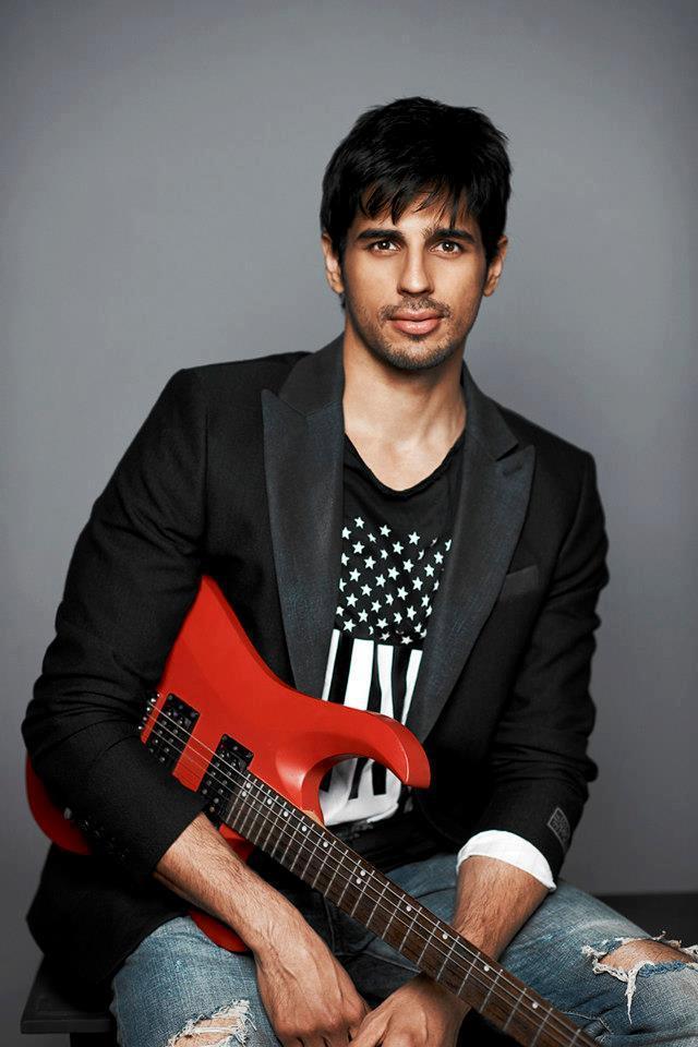Sidharth Malhotra Posed With Guitar Photo Shoot For Dharma