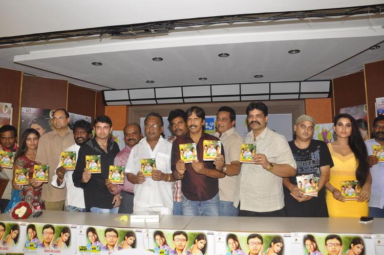 Rohit,T.Prasanna Kumar And Kavya Posed At Half Boil Movie Audio Launch Function