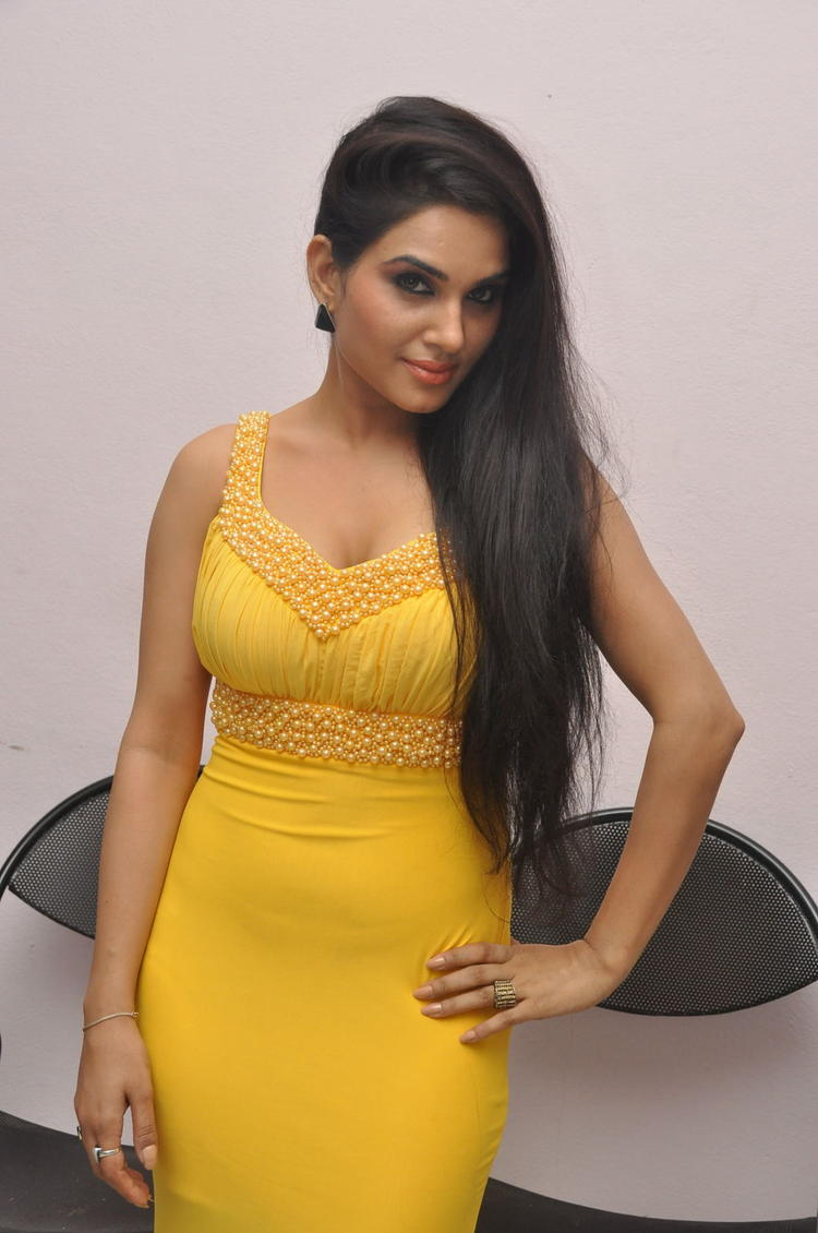 Kavya Singh Glamour Look In Yellow Gown At Half Boil Movie Audio Launch Function