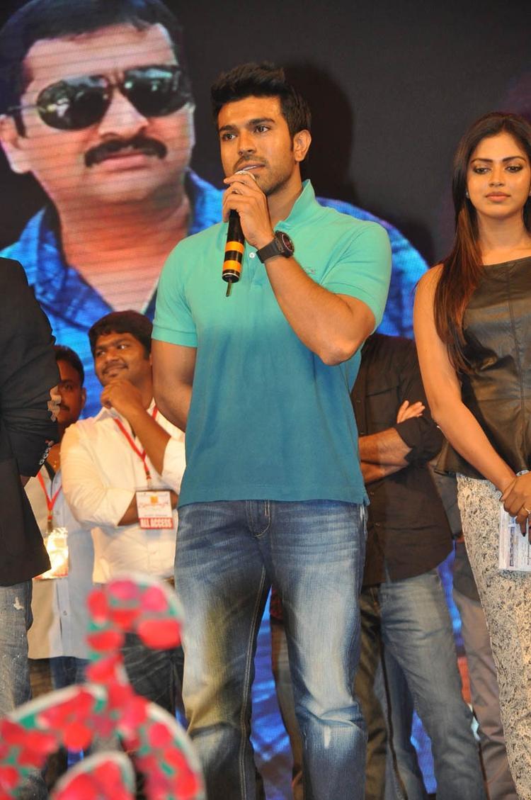 Ram Charan Teja Speaking Still And Amala Paul Looks On At Iddarammayilatho Audio Launch Function