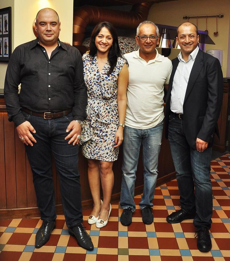 Diego Palladino,Arja Shridhar,Jay Mehta And Sam Malde Posed At KKR Team Dinner Party In Pizza Metro Pizza