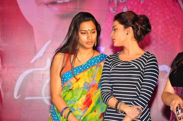 Surekha Vani And Nisha Agarwal Chatting Still At Saradaga Ammaitho Movie Audio Release Function