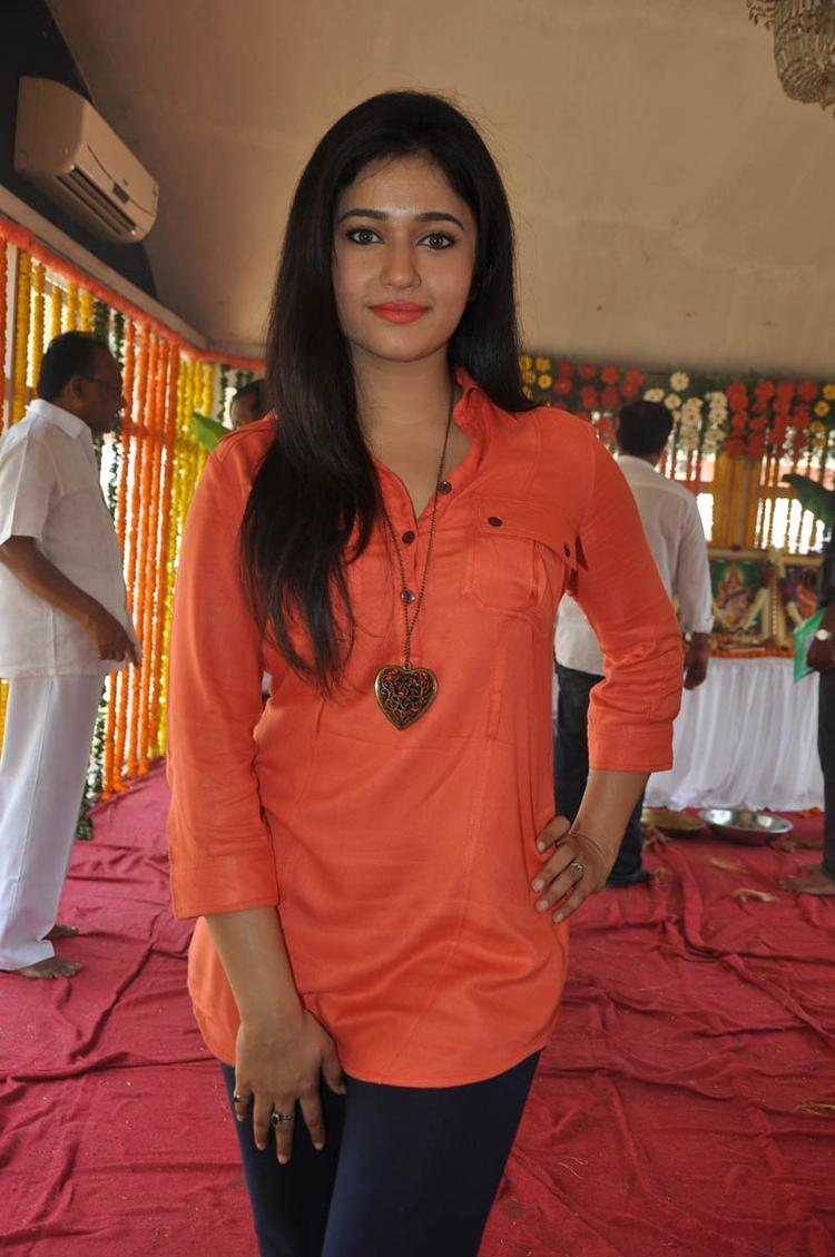 Poonam In Orange Color Dress Glamour Look At H Production Pro No.6 Movie Launch Event