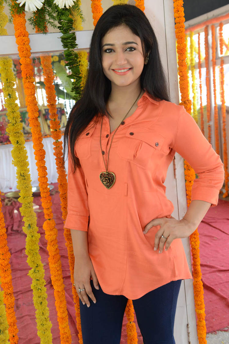 Poonam In Orange Color Dress Smiling Pose At H Production Pro No.6 Movie Launch Event