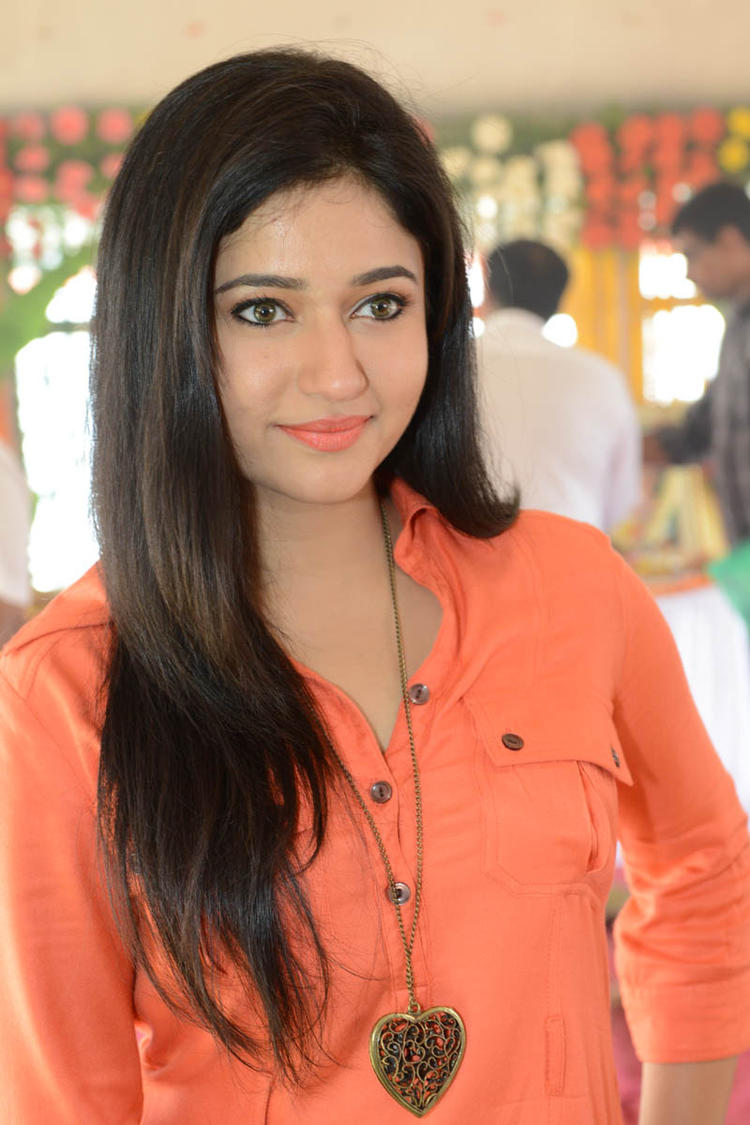 Poonam In Orange Color Dress Stunning Look At H Production Pro No.6 Movie Launch Event