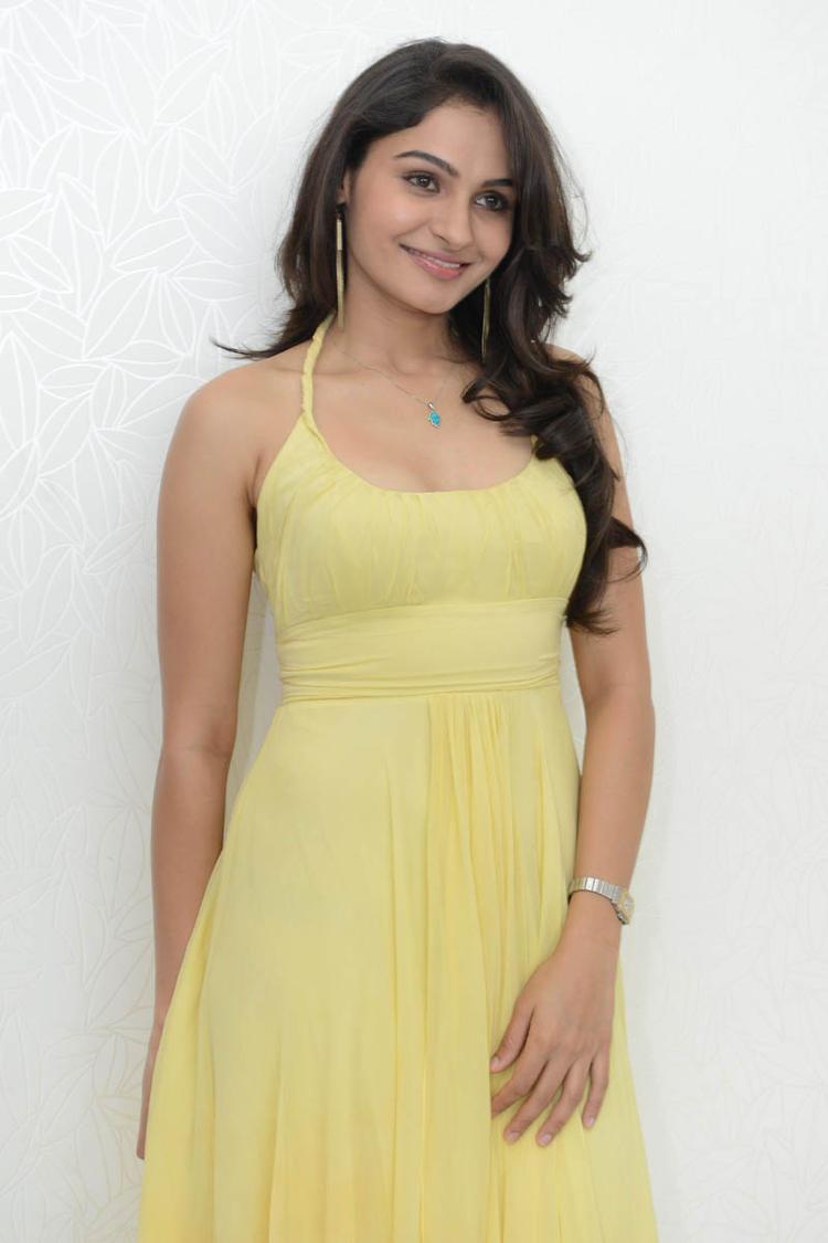 Andrea Photo Shoot At Tadakha Movie Press Meet With Sleeveless Yellow Dress