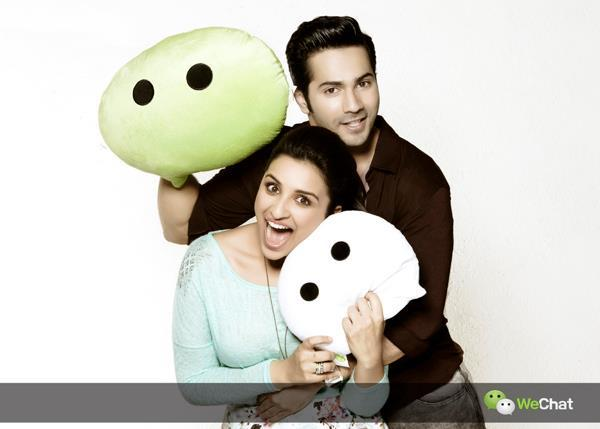 Varun And Parineeti Cool Laughing Pose Photo Shoot For We Chat India TVC Ad