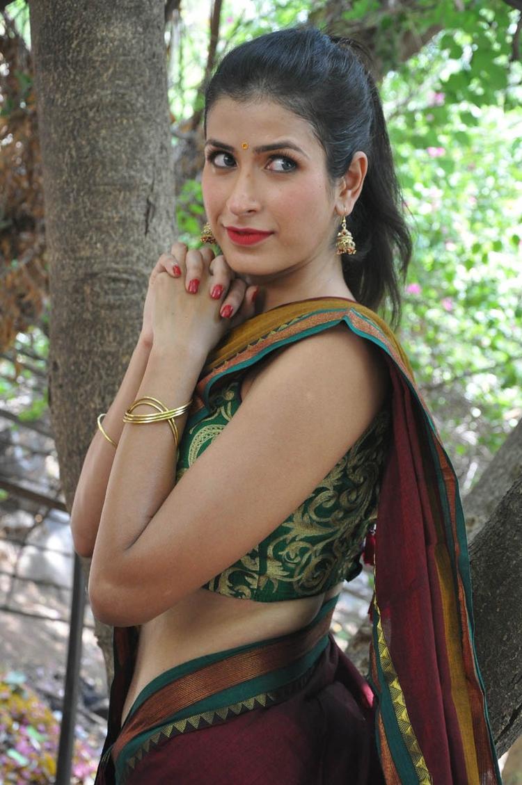 Sonia Birje In Saree Strikes A Pose At Manushulatho Jagartha Movie Opening Function