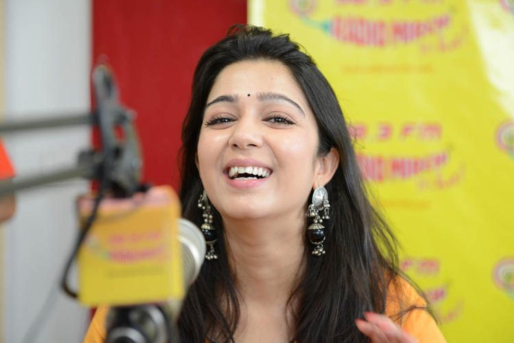 Charmy Kaur Smiling Still During The Promotion Of Prema Oka Maikam Movie At 98.3 FM