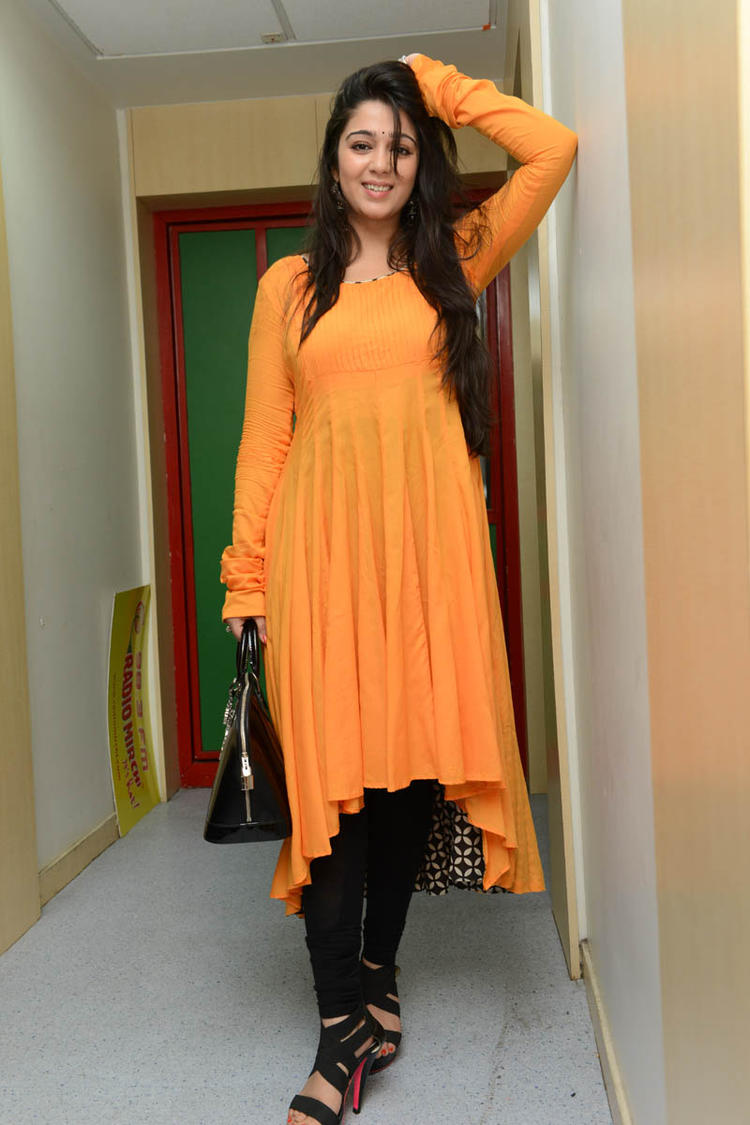 Charmy Kaur Strikes A Pose At Prema Oka Maikam Movie Promotions Event