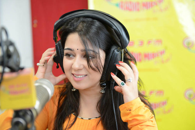 Smiling Charmy Kaur Beautiful Look At 98.3 FM During The Promotion Of Prema Oka Maikam Movie