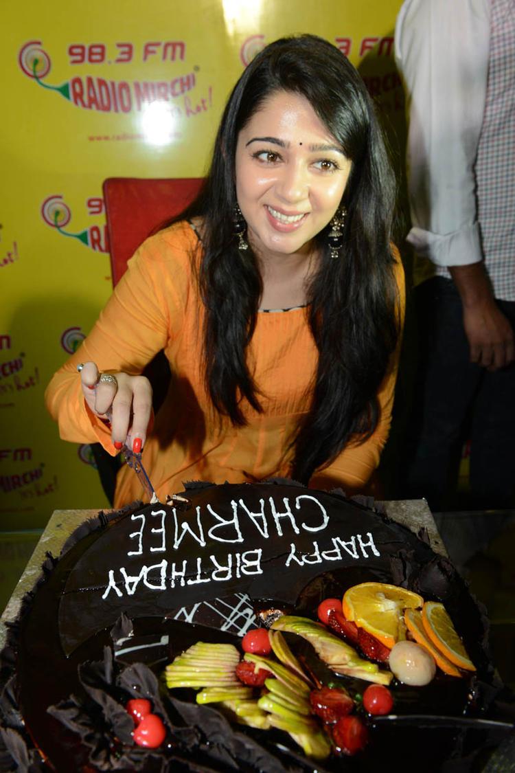 Charmi Kaur Cutting The Cake During The Promotion Event Of Prema Oka Maikam Movie