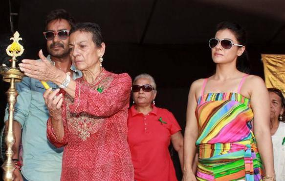 Tanuja Lights The Candle And Ajay,Kajol Look On At Clean Lonavala Program
