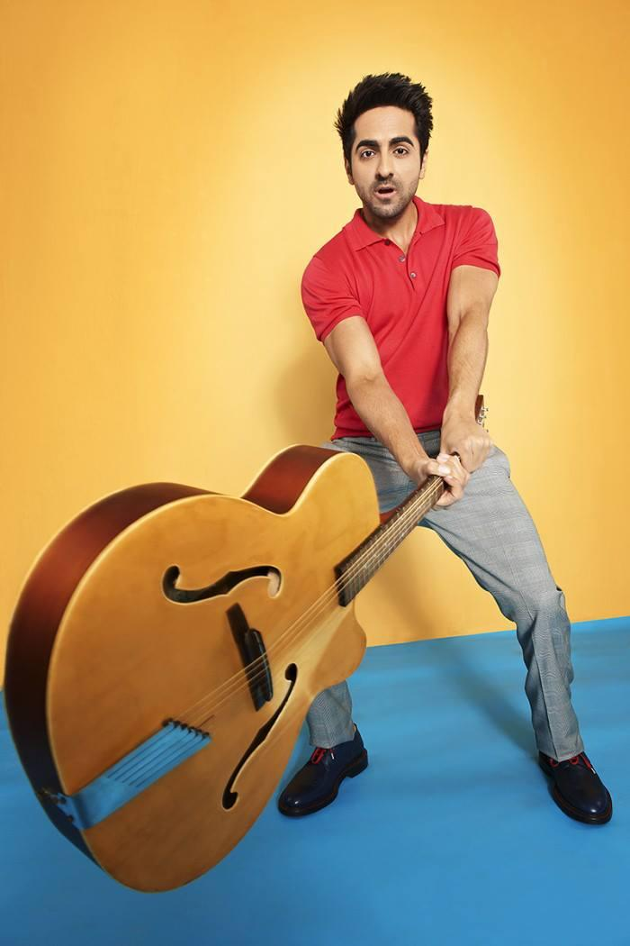 Ayushmann With Guitar For Man's World Magazine Shoot