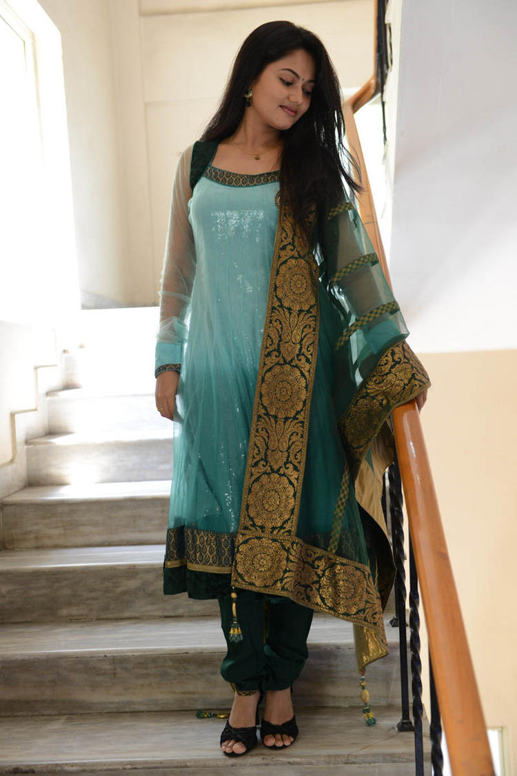Suhasini In Chudidar Dress Posed For Camera At Rough Movie Logo Launch Event