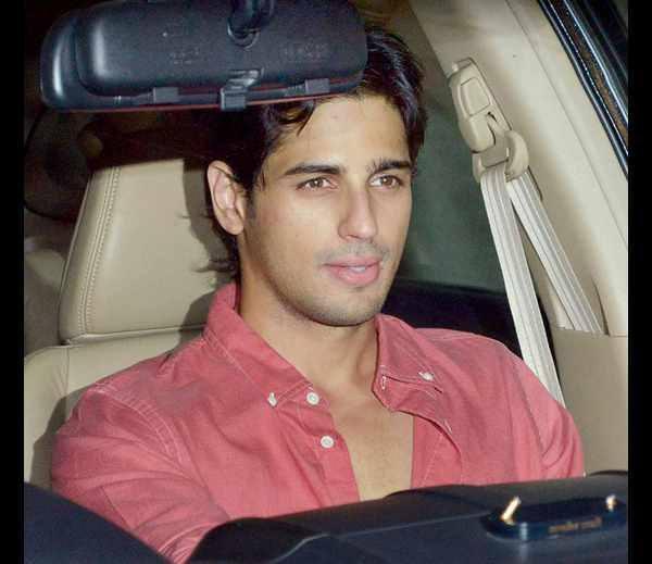 Bollywood Hunk Siddharth Malhotra Arrives At Karan Johar's Birthday Bash