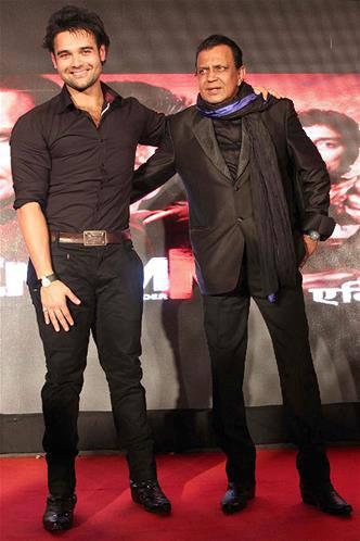 Mithun With Son Mahaakshay During The Music Launch Of Enemmy