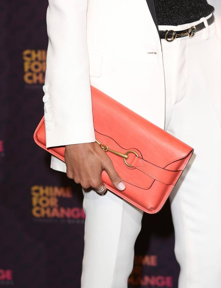 Freida Pinto Shows Her A Coral Clutch At The Chime For Change Concert