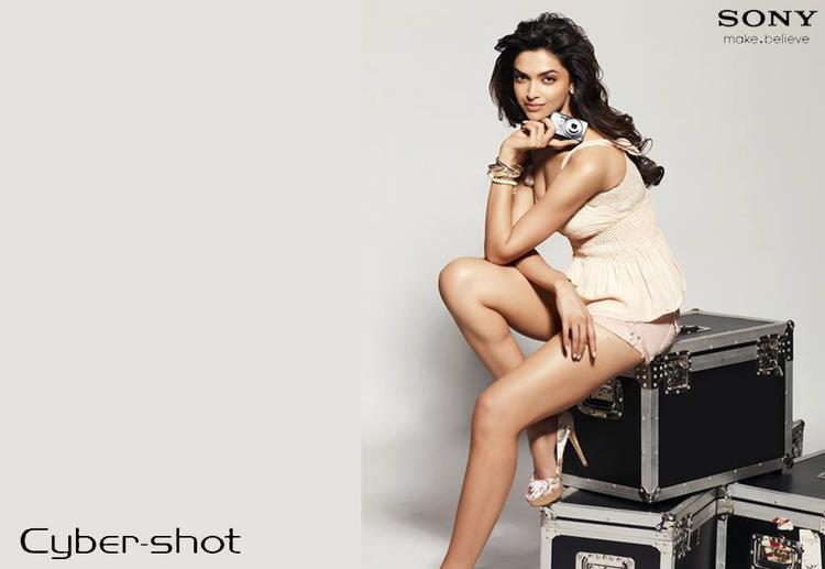 Deepika Padukone Holding A Sony Cybershot In Hand