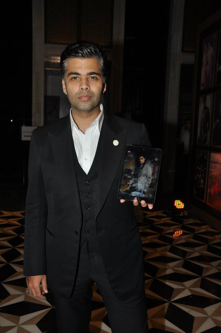 Karan Johar Strikes A Pose During The GQ Best Dressed Party 2013
