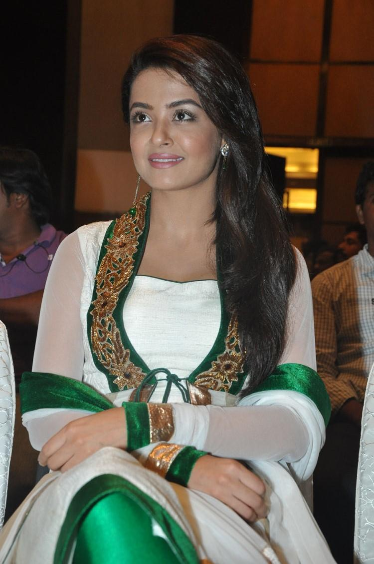 Surveen Chawla Cute Smiling Pose At Jai Hind 2 Movie Press Meet Event