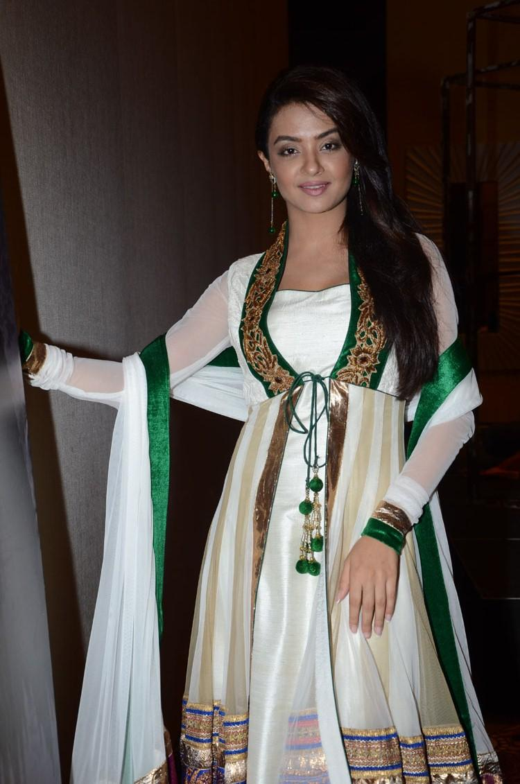 Surveen Chawla Strikes A Posed For Camera At Jai Hind 2 Movie Press Meet Event