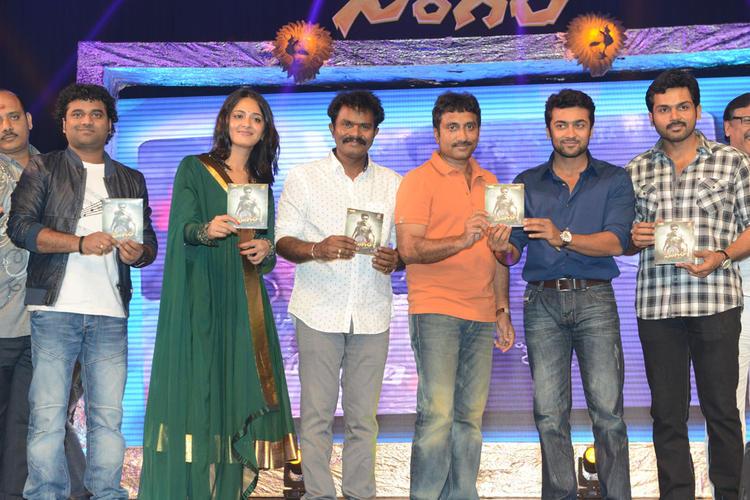 Devi Sri Prasad,Anushka,Srinu,Suriya And Karthi Posed With Audio CD At Singam II Audio Release Function