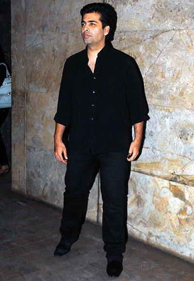 Karan Johar Poses For The Shutterbugs At The Lootera Film Screening