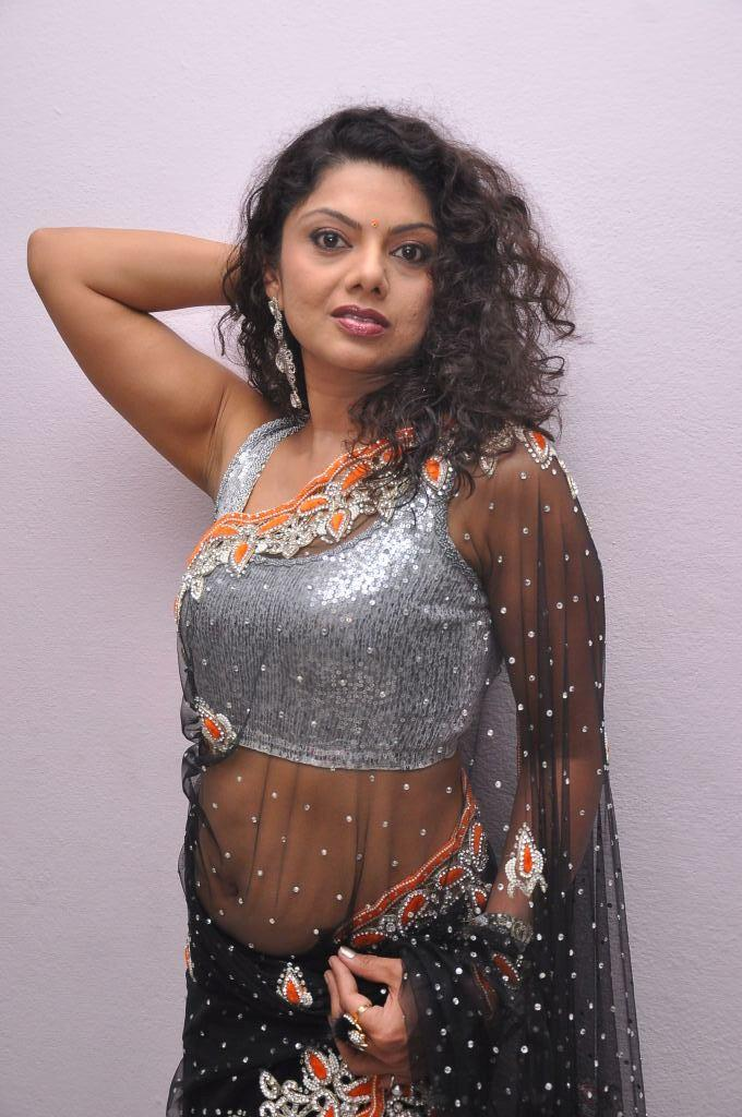 Swathi Varma In Black Transparent Saree Bold Posed At Deal Audio Release Function