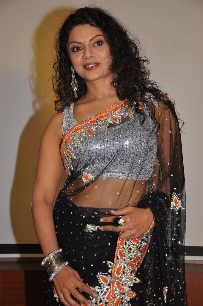 Swathi Varma In Black Transparent Saree Sizzles At Deal Audio Release Function