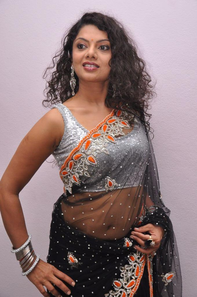 Swathi Varma In Black Transparent Saree Strikes A Pose At Deal Audio Release Function