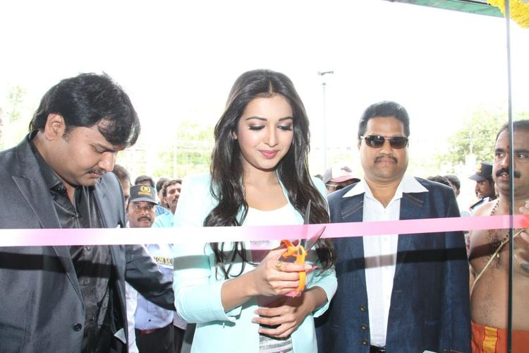 Catherine Tresa Cuts The Ribbon During The Launch Of Big C Mobile Showroom