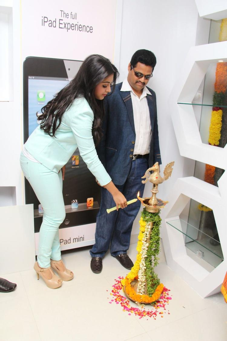 Catherine Tresa Lights The Candle During The Launch Of Big C Mobile Showroom