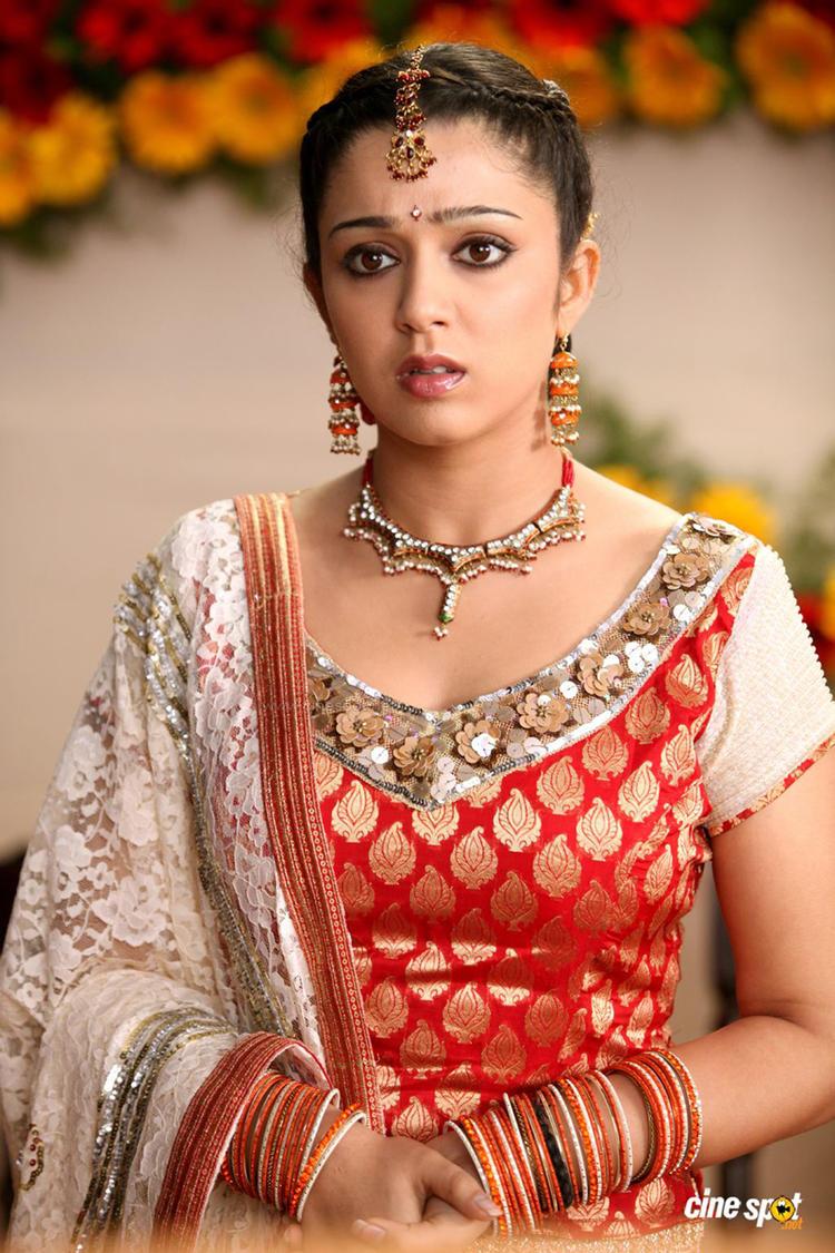 Charmi Kaur Cute Look In Bridal Dress From The Movie Iddaru Khaideelu
