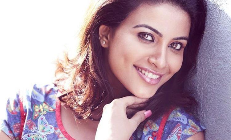 Kavya Shetty Smiling Face Look Hot Photo