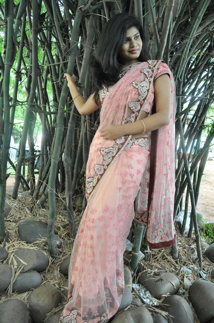 Alekhya Sizzling Pose Photo Shoot In Pink Saree