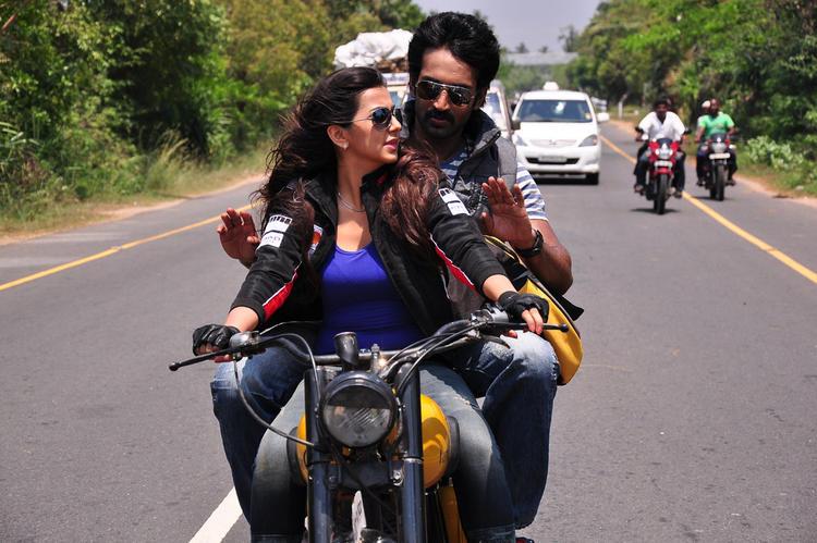 Nikitha And Aadi Latest Still On Bike From The New Movie Aadi Pinisetty
