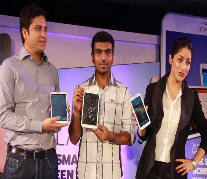 Actress Yami Displays The Newly Launched Galaxy Tab 3 Series During A Launch Event Held In New Delhi