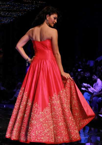 Jacqueline Fernandez Was The Show Stopper Who Walked The Ramp In A Hot Pink Strapless Dress With Slits And Gold Embroidery 
