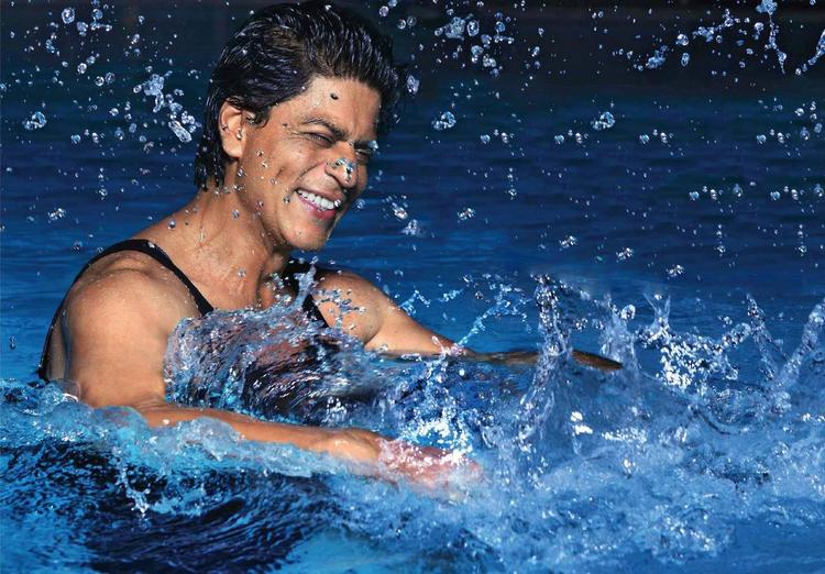 SRK Cool Laughing Pose In Water Photo Shoot For Filmfare Magazine August 2013 Issue