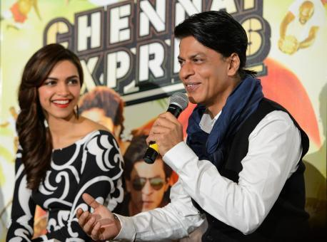 SRK Addresses The Media And Smiling Deepika Looks On During The Promotion Of Chennai Express In London