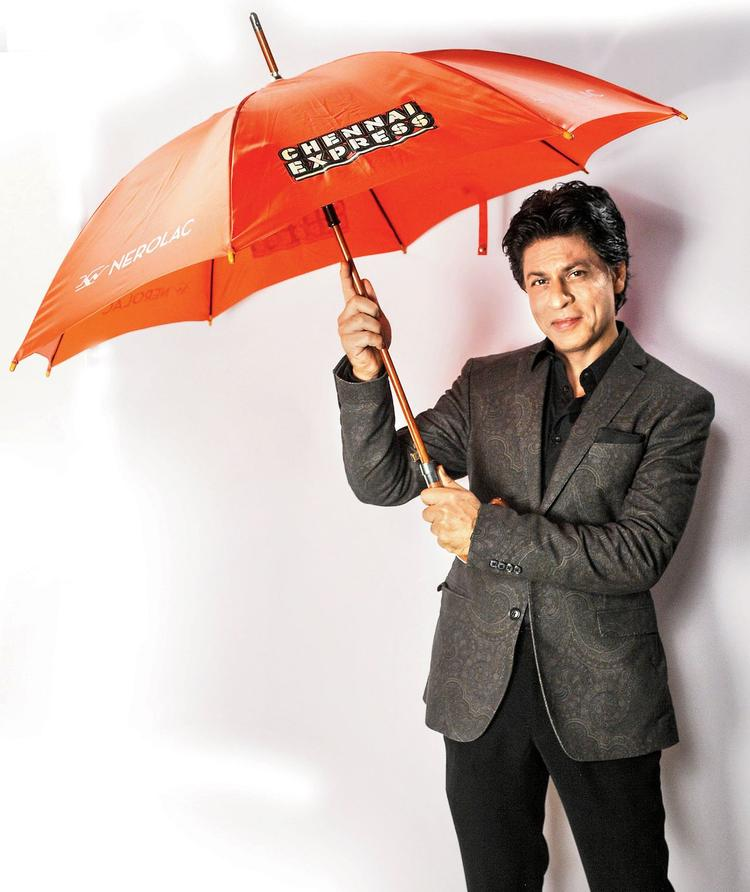 SRK Posed With A Orange Color Umbrella For Kansai Nerolac Paint Ad