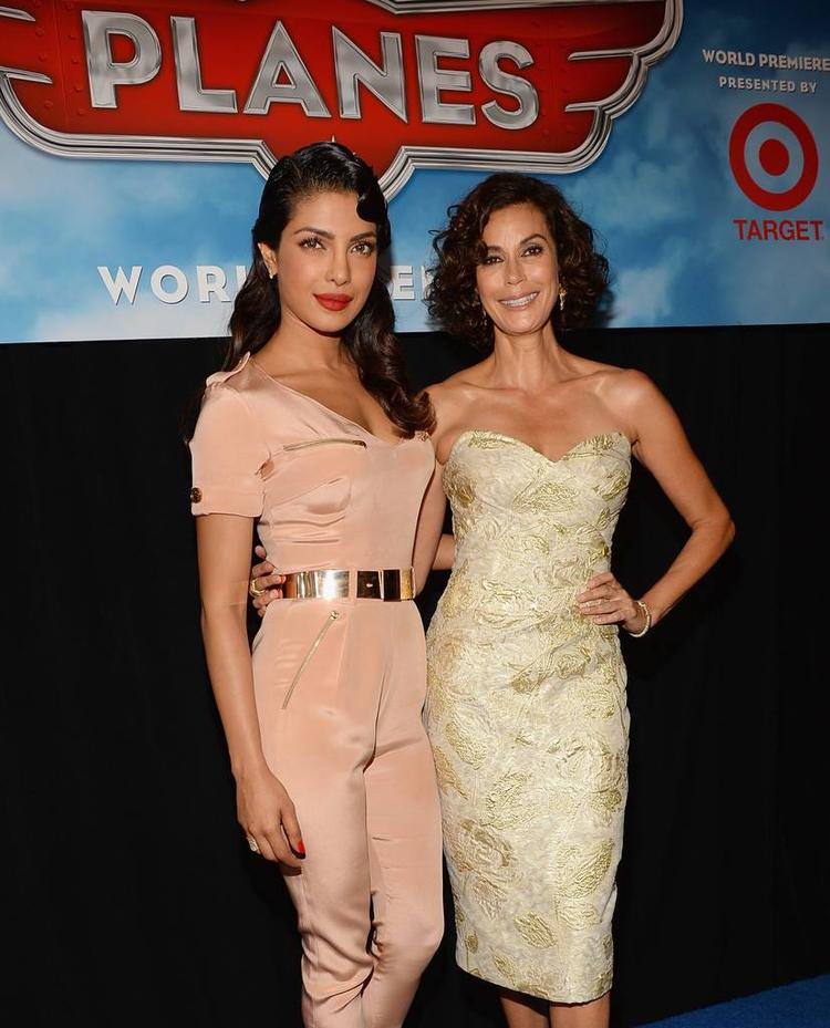 Priyanka And Teri Hatcher Smiling Pose At The Premiere Of Disney's Planes